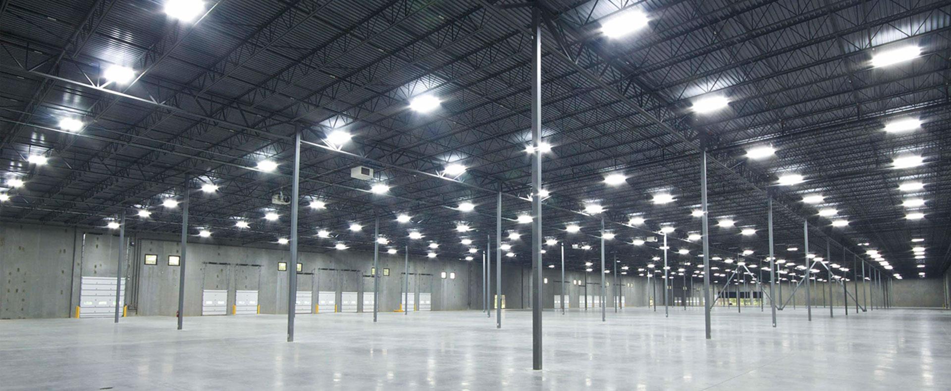 Spacious Interior steel warehouse with key light tracks.